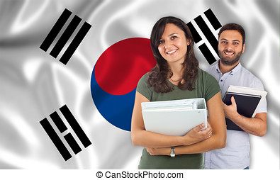 Couple of students over south Korean flag