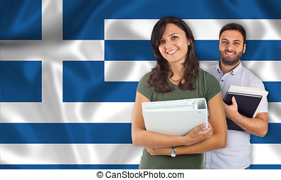 Couple of students over Greek flag - Couple of young...