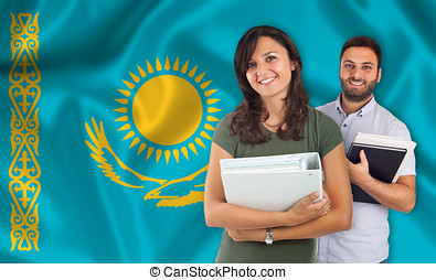 Couple of students overKazakh flag - Couple of young...