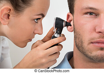 Doctor Examining Man's Ear