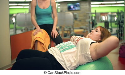 Weight Loss Activity - Side view of overweight lady doing...