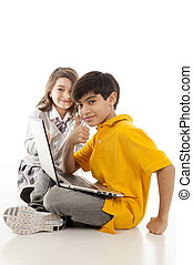 Children - children using a laptop over white background.