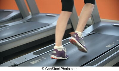 Keeping Fit - Low section of unrecognizable woman exercising...