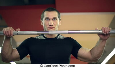 Powerlifting Exercise - Close up of power-lifter holding a...