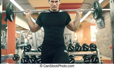 Barbell Back Squat - Tilt up the athlete doing back squats