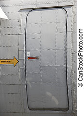 Metallic aircraft emergency and rescue door