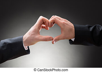 Close-up Of Gay Men Hands Making Heartshape - Close-up Of...