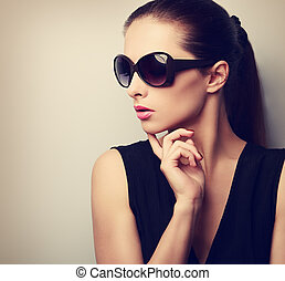 Chic beautiful young female model profile in fashion sunglasses posing