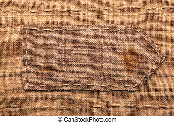 Arrow made of burlap lies on a sacking background,can be...