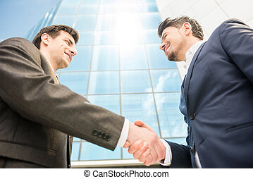 Business solution - Closeup of two successful smiling...