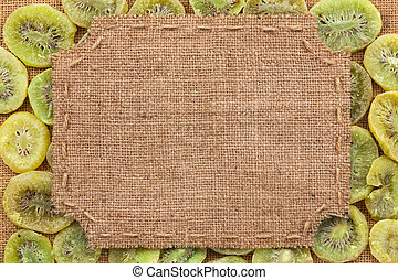 Figured frame made of burlap on dried kiwi, with space for...