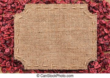 Figured frame made of burlap on dried cranberry, with space...