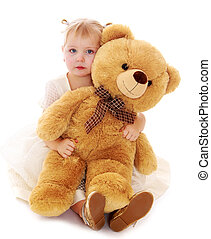 Caucasian little girl hugging a big Teddy bear- isolated on...