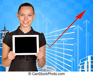 Smiling young woman holding tablet