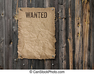 Wanted poster on weathered plank wood wall