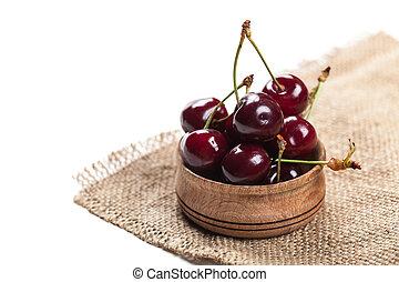 cherries in wooden bowl