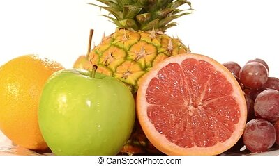 fresh fruit rotating - various types of tropical fruit on...