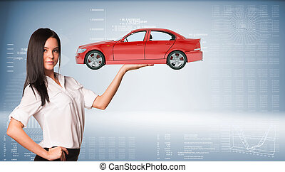 Businesslady holding car on abstract blue background,...