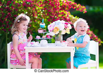 Kids having fun at garden tea party - Tea garden party for...