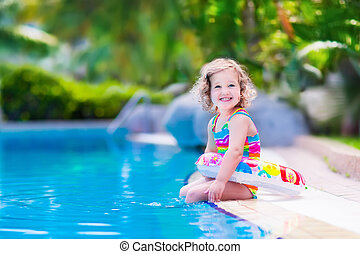 Little girl in swimming pool - Kids in swimming pool....