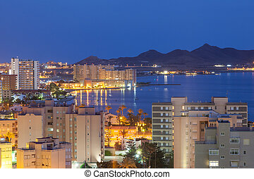 View of La Manga illuminated at night. Region Murcia, Spain