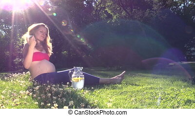 woman drink lemon juice - Beautiful pregnant woman drink...