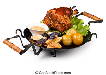 pork knuckle - Appetizing roast pork knuckle on cutting...