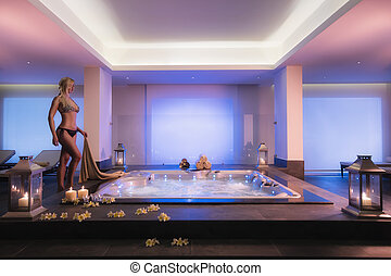 Girl in a jacuzzi - Beautiful girl is going into jacuzzi and...