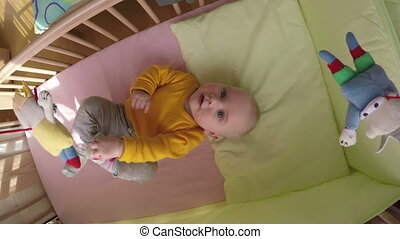 curious baby carousel - Curious newborn baby look at...
