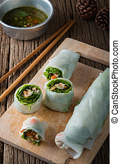 Fresh Spring Rolls with vegetables and pork on old wooden...
