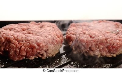 fast food, burgers cooking on grill - burgers cooking on...