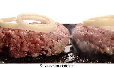 burgers cooking on indoor grill - Burgers cooking with onion...