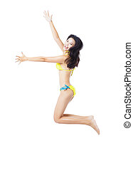 Attractive young woman in swimsuit jumping
