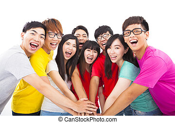 Group of young people with hands together
