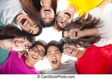 Group of happy young student with arms around each others...