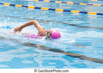 young women is swimming in the pool