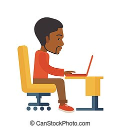 African sitting infront his computer - A black american...