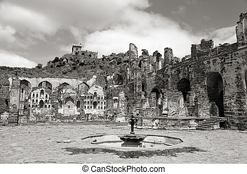 Historic Golkonda fort in Hyderabad, India in monochrome .