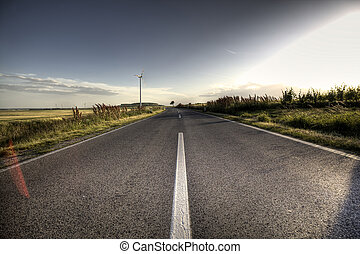 Asphalt road - Country Asphalt road in strong flare with...