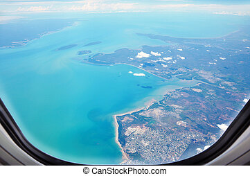 Aerial view of the seacoast from window of the airplane