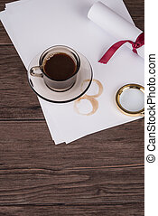 Coffee cup, paper sheets and detective hat