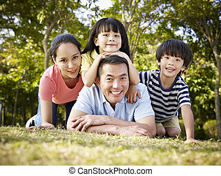 happy asian family with two children taking a family photo...