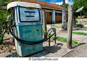 Fuel - Old rusty gas pump in a Brazilian farm.