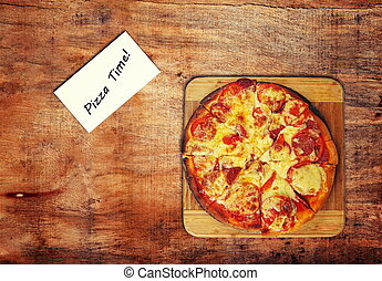 pizza on the wooden table,top view