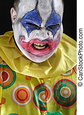 Evil clown - A nasty evil clown, angry and looking mean....