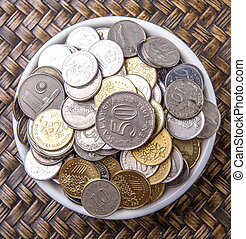 Coins In White Bowl - Malaysian coins in a white bowl over...