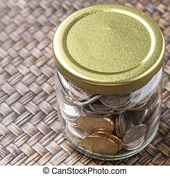 Coins In Mason Jar - Malaysian coins in a mason jar over...