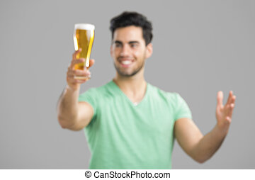 Young man drinking beer - Intensional blured image of young...
