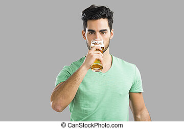 Young man drinking beer - Portrait of handsome young man...