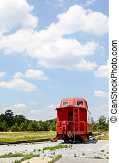 Caboose by Side of Tracks - An old red caboose on a track...